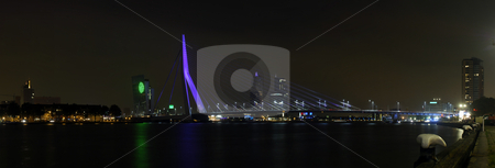 Bridge at Night stock photo, The Erasmus Bridge and the Rotterdam skyline at night; a panoramic image, stitched together fom 22 images. by Corepics VOF
