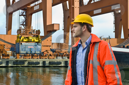 Harbor  stock photo, An engineer, closely watching the unloading of a constainer ship in a harbor environment by Corepics VOF