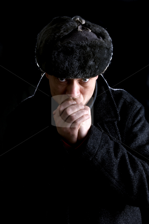 Russian stock photo, A man, dressed as a Russian, warming his hands by Corepics VOF