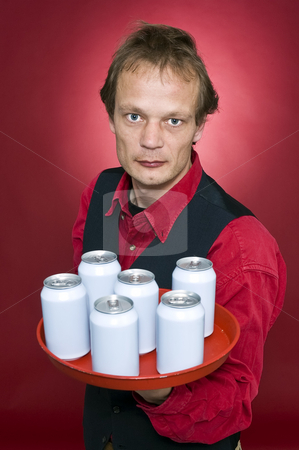 Refreshments stock photo, A waiter holding a tray with six blank cans in front of his chest presenting it to the customer by Corepics VOF