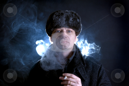 Smoking soviet stock photo, A man, dressed in Soviet attire, smoking a cigarette, surrounded by smoke by Corepics VOF