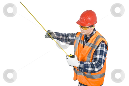 Tape measure stock photo, A construction worker, wearing his personal protection wear, looking at a measurement on a tape measure. Clipping path included by Corepics VOF