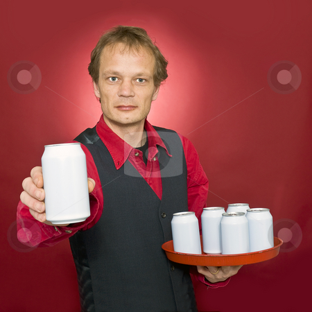 Serving you stock photo, A waiter with a tray of beverage cans holding out one can in his outstetched hand to a customer by Corepics VOF