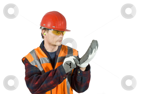 Putting on gloves stock photo, A worker, putting on protective gloves for safety reasons by Corepics VOF
