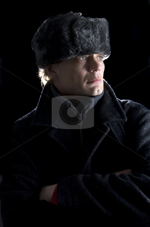 Soviet Man stock photo, A man, dressed in Soviet attire looking away from the camera by Corepics VOF