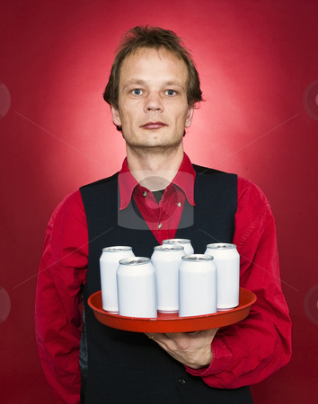 Waiter stock photo, A waiter holding a tray with six blank cans in front of his chest by Corepics VOF