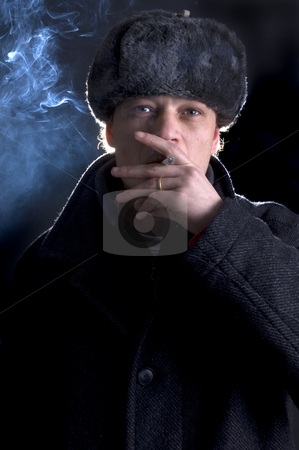 Smoking Soviet stock photo, A man, dressed in a 70's Soviet outfit, smoking a cigarette by Corepics VOF