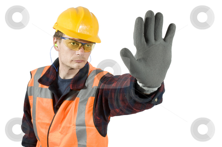 Stop stock photo, Ear plugs goggels and protective gloves giving a stop sign with his hand. Clipping Path included by Corepics VOF