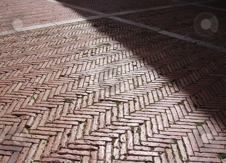 Sunlit walkway stock photo, Sunlit brick walkway with white stripes by Jaime Pharr