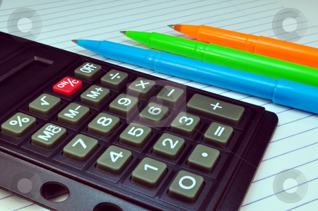 Calculator, pens and notebook stock photo, Calculator and multi color pens over notepad by Fernando Barozza