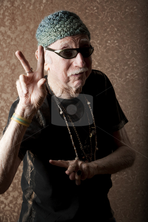 Elderly Hiptser stock photo, Senior man in knit cap making a peace sign by Scott Griessel