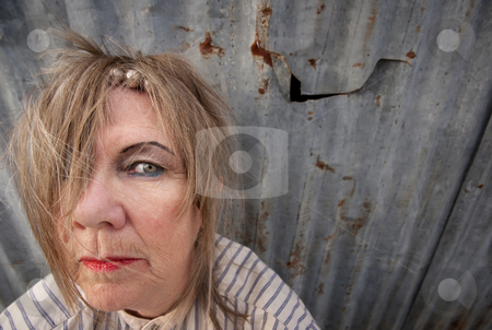 Homeless Woman stock photo, Senior homeless woman with too much makeup by Scott Griessel