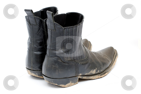Old dirty cowboy boots stock photo, Old dirty cowboy boots by Andrey Butenko