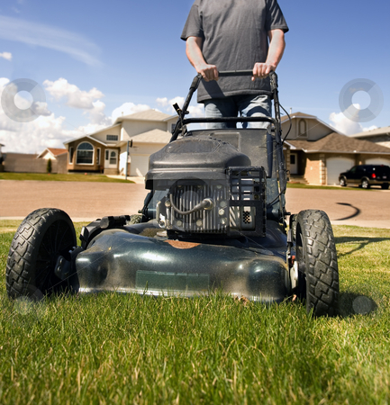 Mow the lawn stock photo, Mowing the front lawn with houses in the background by Steve Mcsweeny