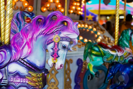 Carousel horse stock photo, A colorful horse close-up on a carousel at the fair by Steve Mcsweeny