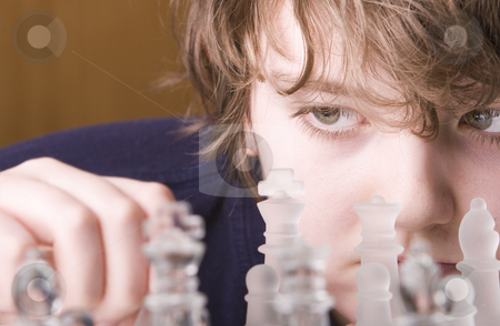 Concentration stock photo, Young boy concentrating while playing a game of chess by Steve Mcsweeny