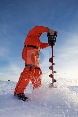 Ice fishing stock photo, Ice fisherman drilling a hole with a power auger by Steve Mcsweeny
