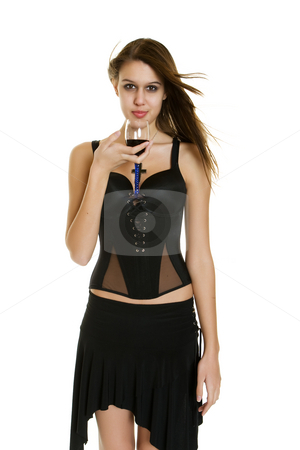 Woman with wine stock photo, A beautiful woman walking with a glass of wine by Steve Mcsweeny
