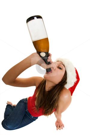 Christmas spirits stock photo, A woman wearing a santa cap drinking champagne. fish eye lens. by Steve Mcsweeny