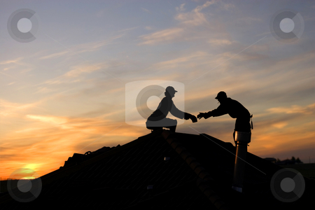 Overtime workers stock photo, Two roofers working late on a roof top by Steve Mcsweeny