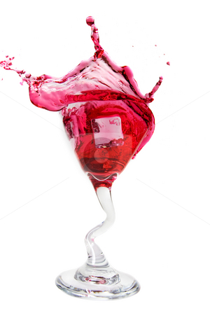 Cranberry splash stock photo, Ice cube dropped into a cranberry martini by Steve Mcsweeny