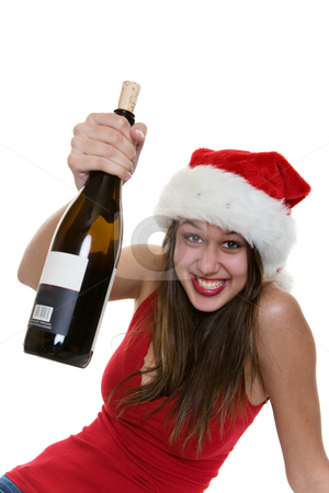Happy cheer stock photo, A happy woman in a santa hat holding a bottle of wine by Steve Mcsweeny