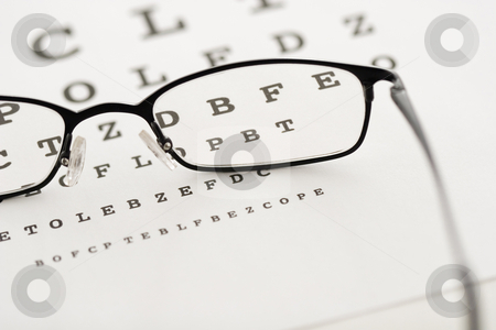 Vision test stock photo, Eye glasses on a test chart by Steve Mcsweeny