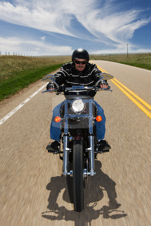 Country travel stock photo, A biker taking a ride on a country highway by Steve Mcsweeny