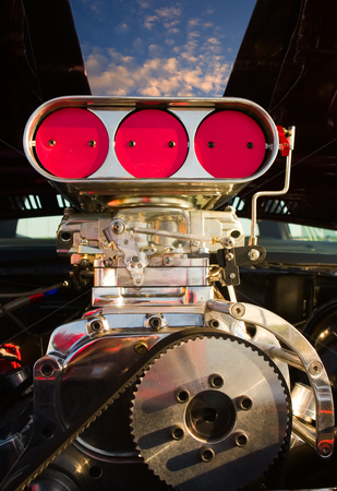 Supercharged engine stock photo, A supercharged engine with blue sky showing through the hood by Steve Mcsweeny