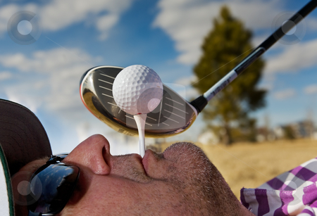 Human Golf Tee stock photo, A golfer holding a tee in his mouth by Steve Mcsweeny