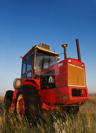 Red Tractor stock photo, Old tractor rusting out in the field by Steve Mcsweeny