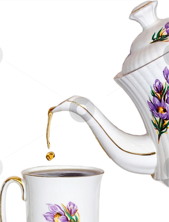 Tea time stock photo, Pouring a drop of tea by Steve Mcsweeny