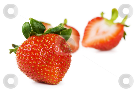 Fresh strawberry stock photo, A strawberry with cut one in the background by Steve Mcsweeny