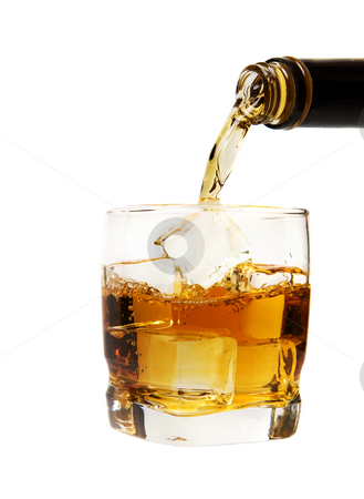 Whiskey mix stock photo, A glass of whiskey being poured on a white background by Steve Mcsweeny
