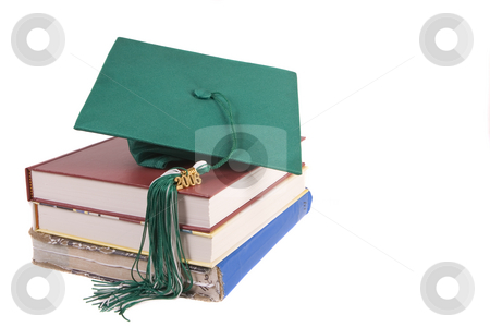 Graduation stock photo, Green graduation hat sitting on top of some school books by Steve Mcsweeny