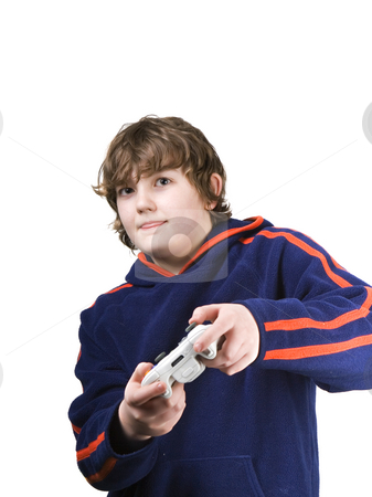 Gamer stock photo, Young boy playing a video game with his tongue out by Steve Mcsweeny