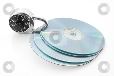 Secure discs stock photo, Combination lock and discs by Steve Mcsweeny