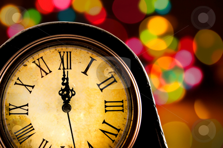 Midnight stock photo, Just before midnight,antique clock with lights in the background by Steve Mcsweeny