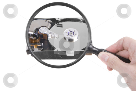 Hard drive magnification stock photo, Holding a magnifying glass over a hard drive by Steve Mcsweeny