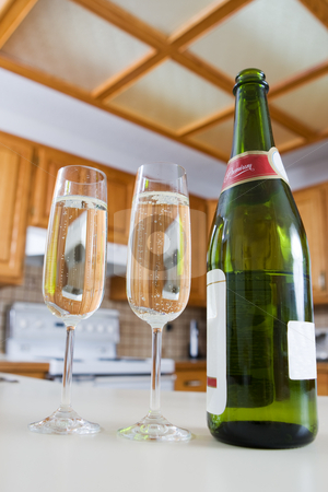 At Home celebration stock photo, A Champagne bottle and drinks in a modern kitchen by Steve Mcsweeny