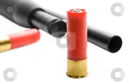 Shotgun ammo stock photo, A close-up of a shotgun shell with gun in the background by Steve Mcsweeny