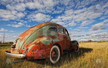 Vintage car stock photo, Vintage car rusting in a prairie field by Steve Mcsweeny