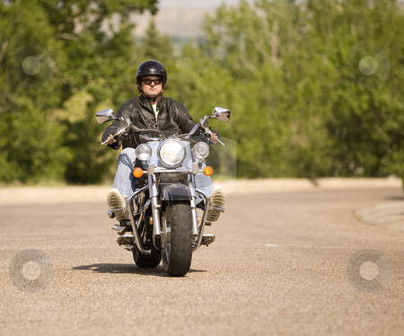 Biker stock photo, Man out for a relaxing ride on his motorcycle by Steve Mcsweeny