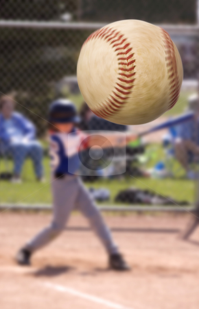 Baseball hit stock photo, Young baseball player hitting a home run , focus on the ball with motion blur by Steve Mcsweeny
