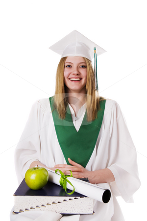 Success stock photo, A teenage graduate with a book apple and diploma(teachers pet concept) by Steve Mcsweeny