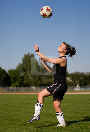 Female soccer player stock photo, A female soccer player getting ready to head the ball by Steve Mcsweeny