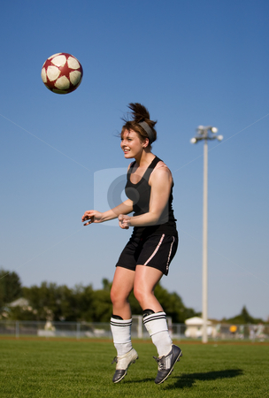Soccer player stock photo, A female soccer player heading the soccer ball by Steve Mcsweeny