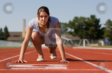 Female fitness stock photo, A pretty young woman exercising at a race track by Steve Mcsweeny