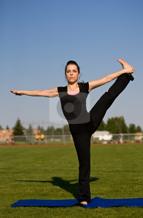 Yoga exercise stock photo, A woman outside exercising and stretching by Steve Mcsweeny