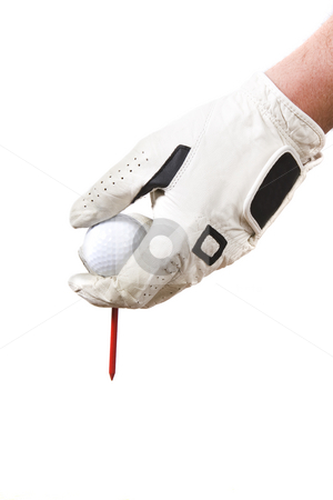 Tee up stock photo, Isolated glove hand setting a golf ball by Steve Mcsweeny